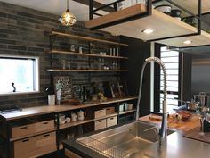 bCd - how would I wire the lighting into the hanging shelves like this? Bakery Kitchen, Loft Kitchen, Rustic Kitchen, Kitchen Interior, Kitchen Design, Urban Kitchen, Kitchen Sets, Kitchen Island Storage, Beautiful Kitchens