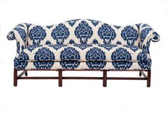 vintage colonial Revival camel-back sofa newly upholstered w/ dark blue & cream Ikat fabric.