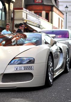 Outrageous is the only way to describe the Bugatti Veyron. The fastest production car in the world with a top speed of Bugatti Cars, Bugatti Veyron, Classy Cars, Sexy Cars, Automobile, Hot Rides, Top Cars, Performance Cars, Expensive Cars