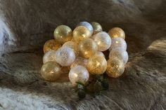 Are they fairy lights or are they baubles?  Both are combined in this delightful string of lighted thread effect silver and gold balls.