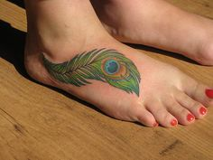 I thought about getting a peacock feather next to my mom's signature on my foot - she actually loved peacocks and we always had weird peacock decorations in our house.