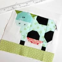 You have to see Daisy Cow Mug Rug by The Patchsmith!
