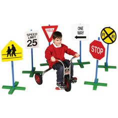 Drivetime Signs - Enhance fun time and teach road rules and safety with kid-sized traffic signs! There are six 30-inch tall signs in a set, sturdy no-tip poles, expanded and weather-proof base with adjustable sign height.