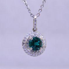 Elegant halo pendant, timeless in style.