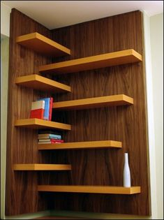 shelving idea... I would do three (2 on one wall and 1 on the other) in the corner of our living room and put pictures and stuff on them... love!