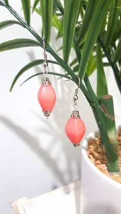 Check out this item in my Etsy shop https://www.etsy.com/au/listing/546915965/vintage-look-pink-drop-earrings