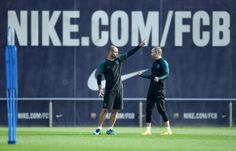 (L-R) Javier Mascherano of Barcelona and Andres Iniesta of Barcelona chat during the FC Barcelona training session at Ciutat Esportiva Joan Gamper on October 18, 2016 in Barcelona, Catalonia.