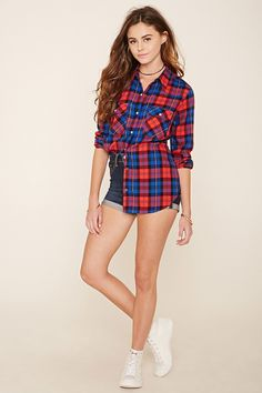 A woven tartan plaid shirt featuring a snap-button front, basic collar, long sleeves, and two snap-buttoned patch pockets.