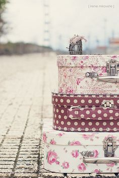 old suitcases, wallpapered, stacked as night stand
