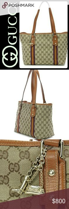"Gucci Italy Canvas Leather Trim Bag Gucci Designer Purse in Iconic GG Web Pattern on a Coated Canvas with Leather Trim! A Must Have Luxury Shoulder Bag with Dual Top Leather Handles (8.5 "" drop) to Carry in Style! Features Gold Tone Boot and Horsebit Clutch Charms on Front!   Made in Italy with Signature Purple Orange Details! Open Top with Main Zipper Pocket and Slip Pocket Inside on a Fully Lined Interior of Purple Textile Fabric! Used with Signs of Wear on Leather Handles, Scuffs on…"