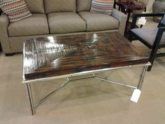 Bamboo coffee table with metal base made by Century Furniture