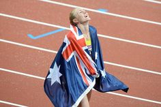 Australia's Sally Pearson on her victory lap after winning gold. Photo by Pat Scala