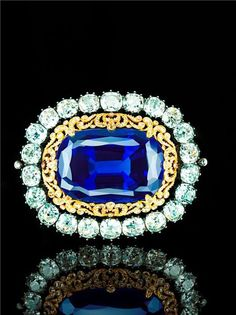 """Brooch with Sapphire - Empress Maria Alexandrovna, the companion to QEII's Romanov Sapphire Brooch, wedding gifts to Princess Marie of Hesse when she married Alexander II. The inner ring is described as """"an openwork rose-cut diamond surround in gold"""" Royal Jewelry, Fine Jewelry, Jewelry Case, Burmese, Antique Jewelry, Vintage Jewelry, Heart Shaped Diamond, Diamond Brooch, Sapphire Jewelry"""