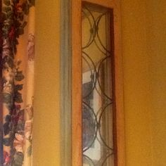Old doors that I trimmed w home depot molding painted and put Walmart mirror behind ....