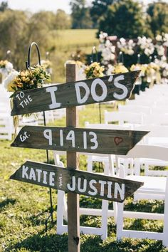 They marked each area of this outdoor wedding with a sign. Each with bright white lettering on contrasting wood.