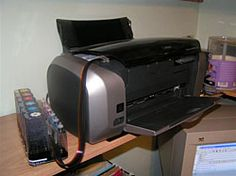 Continuous Ink Systems (printer hack). This guy's full color glossy photos only cost him about $0.30 each.