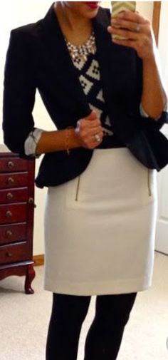 Zipper front skirt with tights, blouse and blazer.