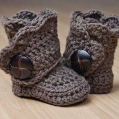 Baby Boots!  i want to learn to crochet well, or knit, or whatever skill i am lacking to make these adorable things.  think i could make them in big kid sizes?