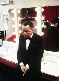 Frank Sinatra in his dressing room at the Sands in Las Vegas, photographed by John Bryson, c. 1964.