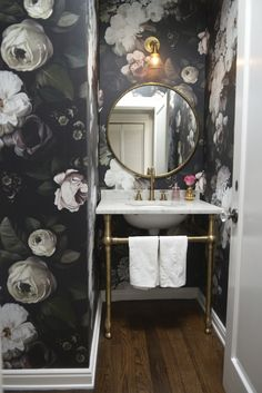 Blogger Cupcakes and cashmere shares her powder room makeover. Bold floor to ceiling flower graphic print wallpaper?