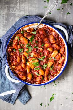 Gigantes plaki is simply giant white beans baked in a rich and fragrant cinnamon sauce. It's a beautiful Greek dish that's naturally vegan and gluten-free.