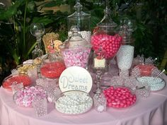 Candy buffet in pinks but prefer purples , great idea for bridal shower theme