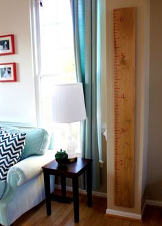 Giant ruler for measuring heights (love the chevron pillows, too)