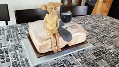 Harry Potter cake with Dobby the house elf made of modeling chocolate, Tom Riddle's diary made of cake, thebsock that freed Dobby, and a bubbling cauldron of polyjuice potion. Free Dobby, Harry Potter Cake, Modeling Chocolate, Cauldron, Elf, Baking, House, Home, Bakken