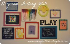 "kid art gallery wall. i like how some of the art is ""fixed"" and other frames are transitional with clothespins to hang the art."