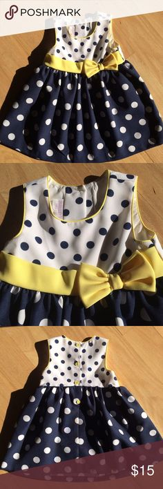 Polka dot dress Bought at Nordstrom Rack and worn once, this dress is too cute to pass up! Dress is white and navy. 100% polyester. Dress will be listed until early February and will be consigned locally if not sold. iris & ivy Dresses Formal