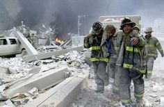 Firefighters Todd Heaney and Frankie DiLeo, of Engine carry injured firefighter from the rubble of the World Trade Center. (Photo by Todd Maisel/NY Daily News Archive via Getty Images) September 2001 ~ Never Forget! World Trade Center, Trade Centre, 11 September 2001, July 9th, Proxy, We Will Never Forget, That Way, American History, Just In Case