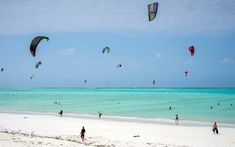 Kitesurfing on a beach of Paje, Zanzibar, Tanzania. Paje is a windy place for good kiting and at the same time, it is safe for the beginners training.