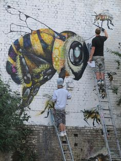 Artist Masai, bee street art in London