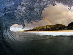 Rainbow through a barrel in Hawaii