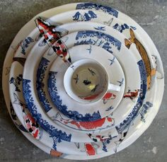"""Mervyn Gers recently won the Best decorated Award at Ceramics South Africa's Cape Regional with his beautiful Koi and Blue Willow Set. """"A series of plates patterned in decals recalling the familiar Willow Pattern designs and the Koi fish of the East."""