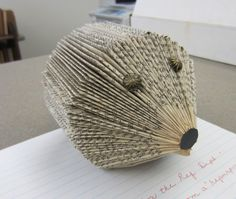 One of our now retired Reference librarians here at the Brookline Public Library today brought us a new mascot for the Reference Department — an adorable hedgehog made from a recycled and folded book. So lovely!  Any name suggestions?