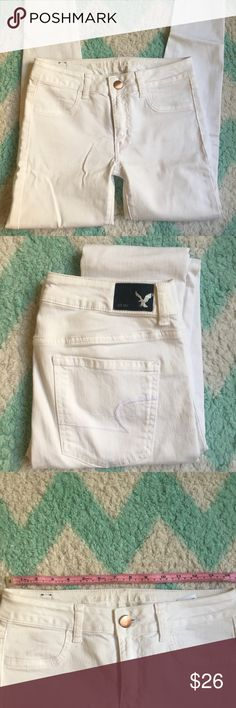 White American Eagle jeans NWOT. Stretchy. See pics for measurements. Let me know if you want to see it modeled. American Eagle Outfitters Pants Skinny
