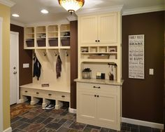 This mud/laundry room helps organize life for an active busy family. abinetry provides a great spot spot for keys, mail, or sunglasses.