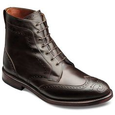 """""""If you want dress boots that are good in the rain, the leather you want is called Shell Cordovan. It's a thick leather that's naturally rain resistant. Also, go with a dark color. It looks better against the wet concrete and doesn't show water spots as much."""""""