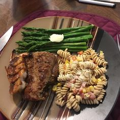Dinner tonight includes  BBQ Ribs and Shrimp Asparagus  And Leftover Pasta salad