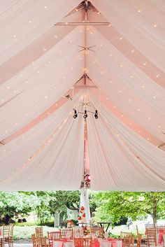 wedding tent gently pink awning on tables pink tablecloths lori hedrick photography