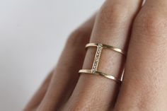 Model wearing a minimalist Gold and Diamond double band ring