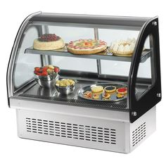 """This Vollrath 40842 36"""" curved glass refrigerated display cabinet features an attractive base that allows the unit to be installed into a counter as a drop in that blends seamlessly into your establishment, <i>or</i> as a countertop unit for optimum flexibility and space-saving efficiency! Perfect for whipped cakes, pies, creamy pastries and other chilled treats, it boasts a digitally controlled thermostat that provides precise, consistent performance at temperatures ran..."""