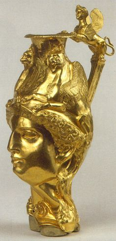 At right: Golden vessel in the form of a goddess head crowned by griffins, with a winged sphinx handle. From Panagurishte, Bulgaria Thracian treasure