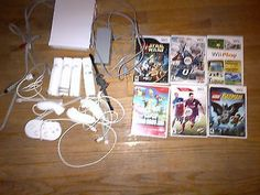 wii console with 4 controllers including 6 games