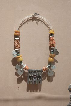 // necklace with amulet pendant