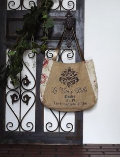 ROSABELLA: handpainted Italian BURLAP TOTE - burlap and  floral fabric in red / rose with metallic bronze leather straps by Eurocentrics. $59.00, via Etsy.
