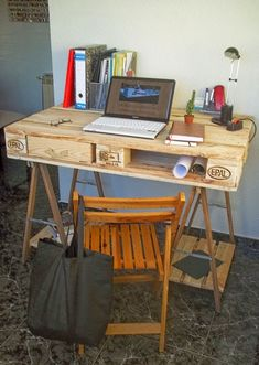 Desk made from a pallet and 2 table trestles 1