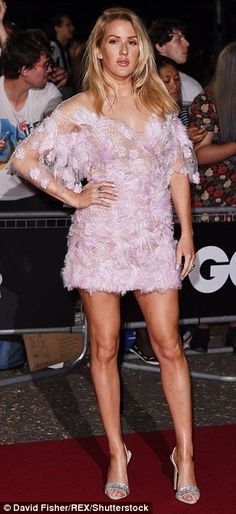 That girl is on FIRE! Burn singer Ellie lived up to the title of her song, as she made a sizzling arrival on the red carpet in a sassy pink mini dress