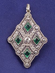 Art Deco Platinum, Emerald, and Diamond Pendant/Brooch, the openwork mount bead and bezel-set with old mine and old European-cut diamonds, four fancy-cut emeralds, millegrain accents